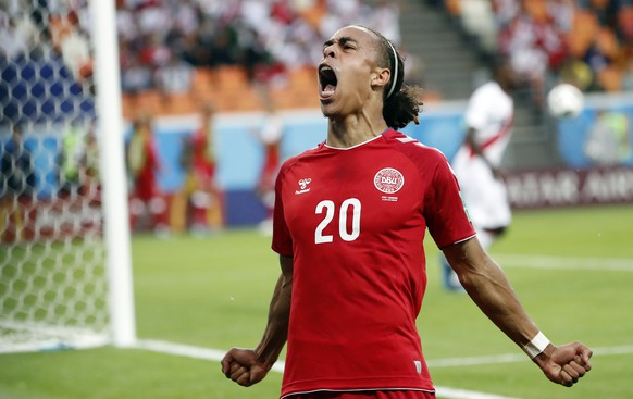 epa06814015 Yussuf Poulsen of Denmark celebrates scoring the 1-0 during the FIFA World Cup 2018 group C preliminary round soccer match between Peru and Denmark in Saransk, Russia, 16 June 2018.  (RESTRICTIONS APPLY: Editorial Use Only, not used in association with any commercial entity - Images must not be used in any form of alert service or push service of any kind including via mobile alert services, downloads to mobile devices or MMS messaging - Images must appear as still images and must not emulate match action video footage - No alteration is made to, and no text or image is superimposed over, any published image which: (a) intentionally obscures or removes a sponsor identification image; or (b) adds or overlays the commercial identification of any third party which is not officially associated with the FIFA World Cup)  EPA/ERIK S. LESSER   EDITORIAL USE ONLY  EDITORIAL USE ONLY
