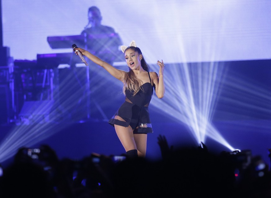 FILE - In this Aug. 26, 2015 file photo, Ariana Grande performs during the honeymoon tour concert in Jakarta, Indonesia. Officials in  Manchester  England said Wednesday July 12, 2017, that they are making U.S. pop singer Ariana Grande an honorary citizen of the city because of her response to the deadly concert attack in May. (AP Photo/Achmad Ibrahim, File)