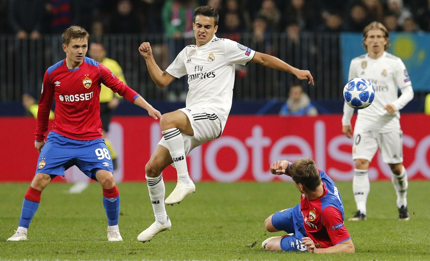 Real defender Sergio Reguilon, second left, challenge for the ball with CSKA midfielder Jaka Bijol, bottom, during a Group G Champions League soccer match between CSKA Moscow and Real Madrid at the Luzhniki Stadium in Moscow, Russia, Tuesday, Oct. 2, 2018. (AP Photo/Alexander Zemlianichenko)