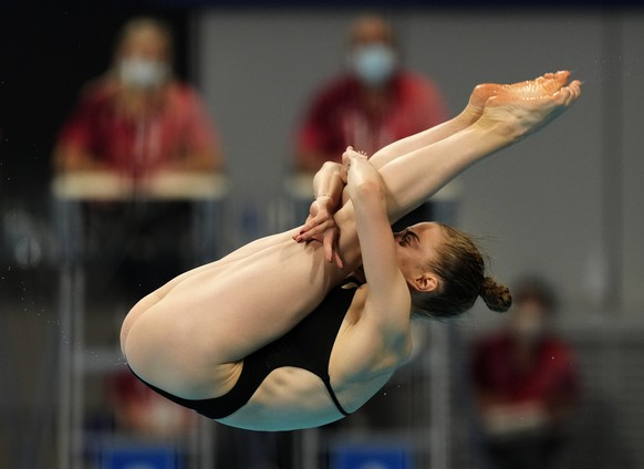 Michelle Heimberg of Switzerland competes in women's diving 3m springboard semifinal at the Tokyo Aquatics Centre at the 2020 Summer Olympics, Saturday, July 31, 2021, in Tokyo, Japan. (AP Photo/Dmitri Lovetsky)