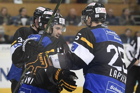 Lugano's Luca Fazzini, left, celebrates with teammates after scoring 3-1 during the game between HC Lugano and Mountfield HK at the 90th Spengler Cup ice hockey tournament in Davos, Switzerland, Wednesday, December 28, 2016. (KEYSTONE/Gian Ehrenzeller)