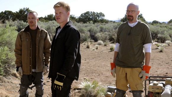 This image released by AMC shows, from left, Jesse Pinkman, played by Aaron Paul, Todd Alquist, played by Jesse Plemons and Walter White, played by Bryan Cranston during the heist of methylamine in the fifth season of