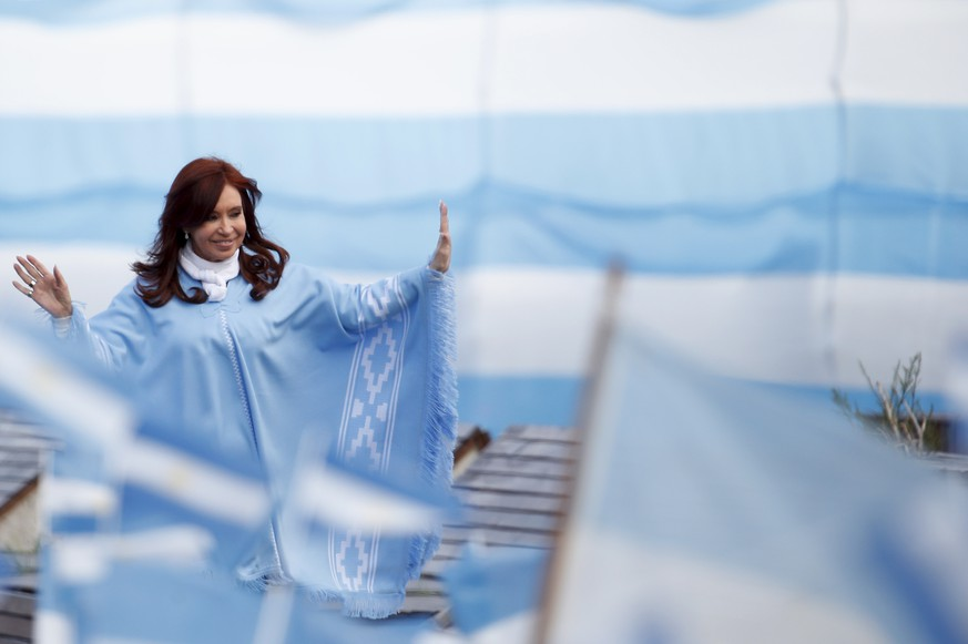 Former President Cristina Fernandez de Kirchner, who is on a presidential ticket as a vice presidential candidate, waves to supporters as she arrives for a closing campaign rally, in Mar Del Plata, Argentina, Thursday, Oct. 24, 2019. Argentina will hold presidential elections on Sunday. (AP Photo/Natacha Pisarenko) Cristina Fernandez de Kirchner