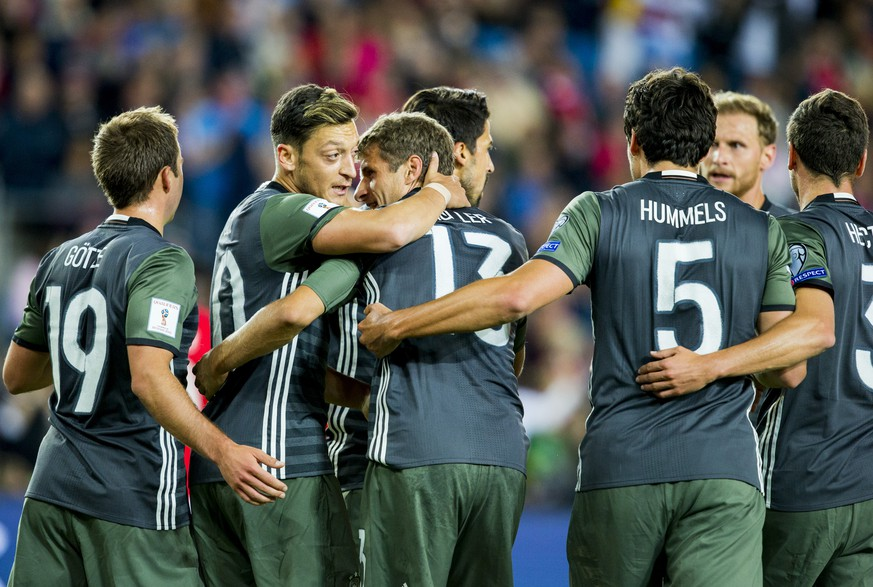Germany's Thomas Muller, center, celebrates with teammates after scoring against Norway during their World Cup Group C qualifying soccer match in Oslo, Sunday, Sept. 4, 2016. (Vegard Wivestad Grott/NTB Scanpix via AP)