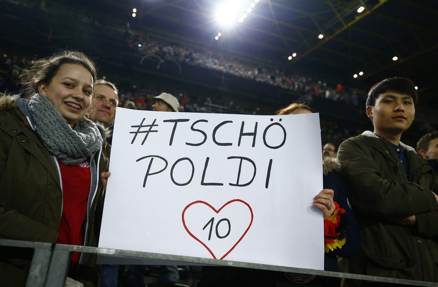 Football Soccer - Germany v England - International Friendly - Signal-Iduna-Park, Dortmund, Germany - 22/3/17 Germany fans hold up a banner for Lukas Podolski before the match Reuters / Wolfgang Rattay Livepic