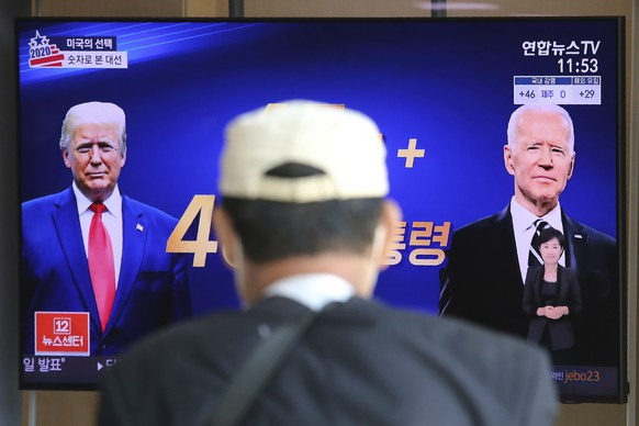 A TV screen shows images of U.S. President Donald Trump, left, and Democratic presidential candidate former Vice President Joe Biden during a news program at the Seoul Railway Station in Seoul, South Korea, Tuesday, Nov. 3, 2020. The U.S. presidential election is scheduled for Tuesday. (AP Photo/Ahn Young-joon)