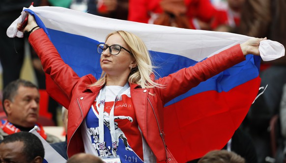 epa06807073 A Russian fan before the FIFA World Cup 2018 group A preliminary round soccer match between Russia and Saudi Arabia in Moscow, Russia, 14 June 2018.  (RESTRICTIONS APPLY: Editorial Use Only, not used in association with any commercial entity - Images must not be used in any form of alert service or push service of any kind including via mobile alert services, downloads to mobile devices or MMS messaging - Images must appear as still images and must not emulate match action video footage - No alteration is made to, and no text or image is superimposed over, any published image which: (a) intentionally obscures or removes a sponsor identification image; or (b) adds or overlays the commercial identification of any third party which is not officially associated with the FIFA World Cup)  EPA/YURI KOCHETKOV   EDITORIAL USE ONLY