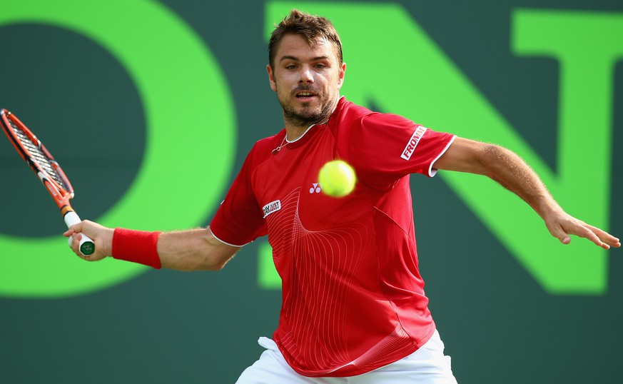 KEY BISCAYNE, FL - MARCH 24:  Stanislas Wawrinka of Switzerland returns a shot against Edourard Roger Vasselin of France during their match on day 8 of the Sony Open at Crandon Park Tennis Center on March 24, 2014 in Key Biscayne, Florida.  (Photo by Al Bello/Getty Images)