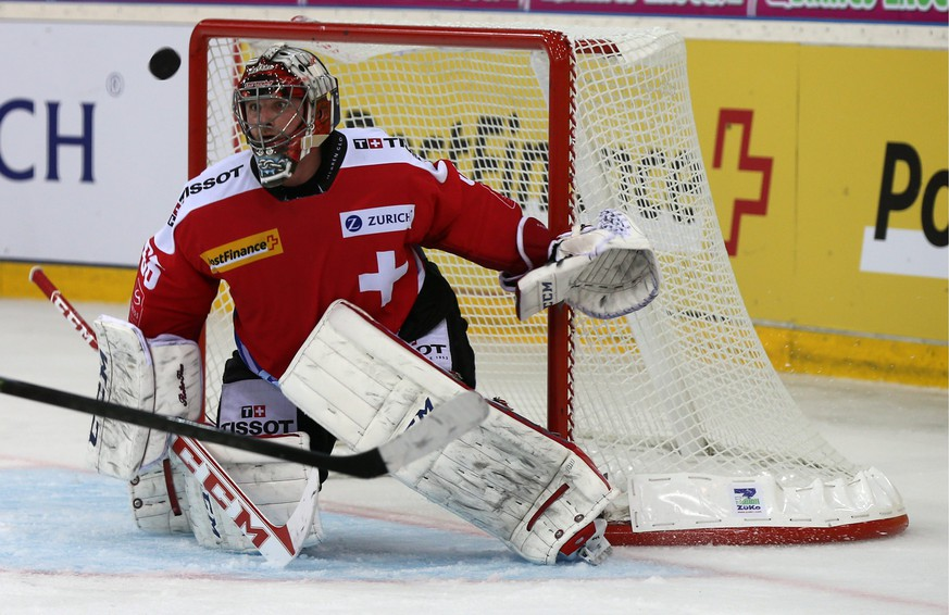 Switzerland's goalkeeper Robert Mayer in action during a friendly ice hockey game between Switzerland and Czech Republic, at the St. Jakob Arena in Basel, Switzerland, Sunday, April 27, 2014. (KEYSTONE/Patrick Straub)