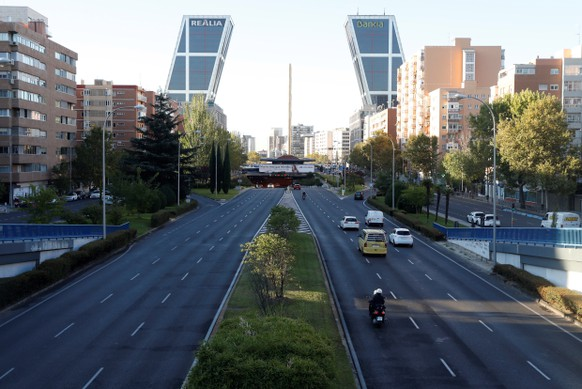 epa08723451 View of Castellana Avenue with very little traffic in downtown in Madrid, Spain, 06 October 2020. Madrid capital city and other 9 towns in the region have been 'closed' by the central Government to avoid mobility between those cities with high number of coronavirus cases amid a dispute between the central and regional Governments on how to lower down the epidemiological curve in the region. Madrid's regional Government filed a complaint at the Audiencia Nacional Court to avoid the closure of cities but restrictions have been carried out while the court rules out a decision on the matter.  EPA/J.J Guillen