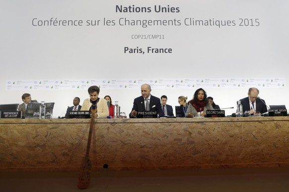 French Foreign Minister Laurent Fabius (C), President-designate of COP21, and Secretary of the UN Framework Convention on Climate Change, Christiana Figueres (L), attend the World Climate Change Conference 2015 (COP21) at Le Bourget, near Paris, France, December 9, 2015.  REUTERS/Stephane Mahe