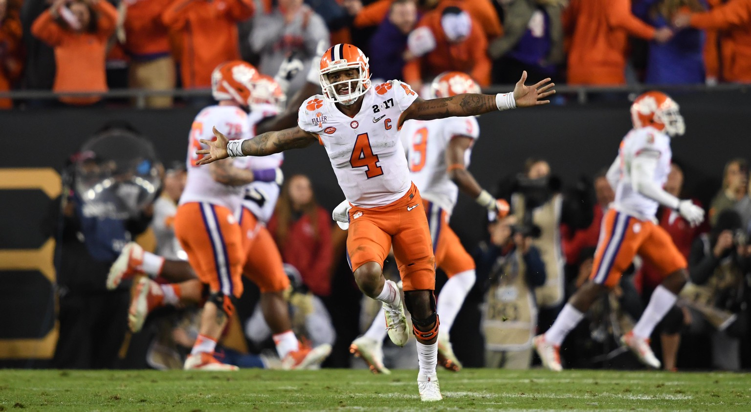 Jan 9, 2017; Tampa, FL, USA; Clemson Tigers quarterback Deshaun Watson (4) celebrates during the fourth quarter against the Alabama Crimson Tide in the 2017 College Football Playoff National Championship Game at Raymond James Stadium. Mandatory Credit: John David Mercer-USA TODAY Sports