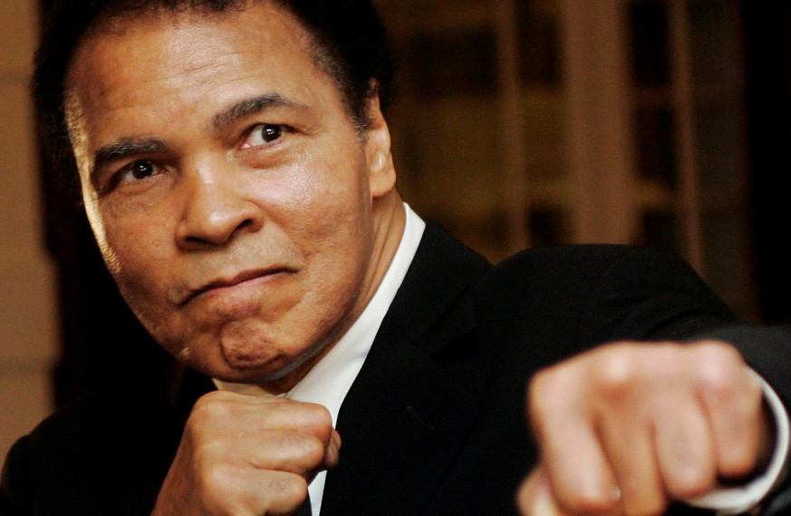 U.S. boxing great Muhammad Ali poses during the Crystal Award ceremony at the World Economic Forum (WEF) in Davos, Switzerland, in this January 28, 2006 file photo. REUTERS/Andreas Meier/File Photo     TPX IMAGES OF THE DAY