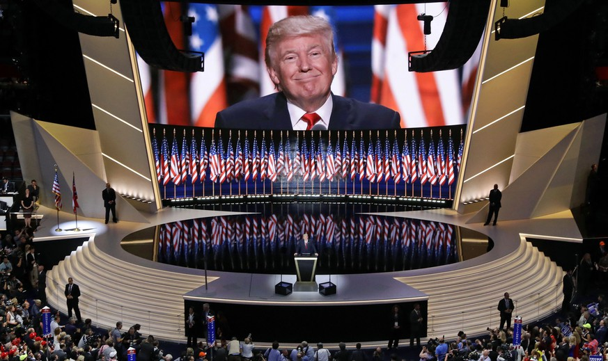 In this July 21, 2016 photo, Republican presidential candidate Donald Trump smiles as he addresses delegates during the final day session of the Republican National Convention in Cleveland. For eight summer nights, there were two starkly different visions of America at the Republican and Democratic political conventions.   (AP Photo/Patrick Semansky)