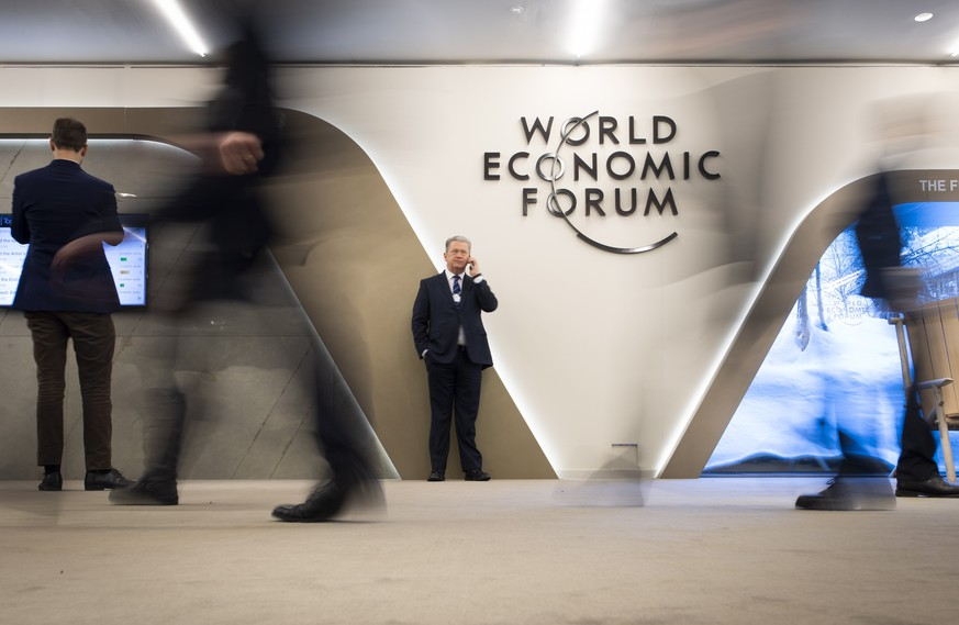 epa08868577 FILE - Participants walk trough the halls during the 49th annual meeting of the World Economic Forum, WEF, in Davos, Switzerland, 24 January 2019 (reissued 07 December 2020). The next WEF will take place in Singapore in spring 2021, not in Switzerland, like the previous years, media announced on 07 December 2020.  EPA/GIAN EHRENZELLER   NO SALES/NO ARCHIVES