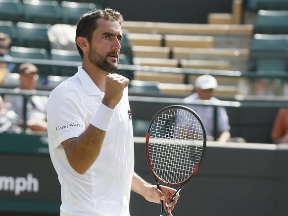 Croatia's Marin Cilic celebrates after winning the Men's Singles Match against Steve Johnson of the United States on day five at the Wimbledon Tennis Championships in London Friday, July 7, 2017. (AP Photo/Kirsty Wigglesworth)