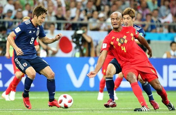 epa06859051 Genki Haraguchi (L) of Japan in action against Vincent Kompany (R) of Belgium during the FIFA World Cup 2018 round of 16 soccer match between Belgium and Japan in Rostov-On-Don, Russia, 02 July 2018.