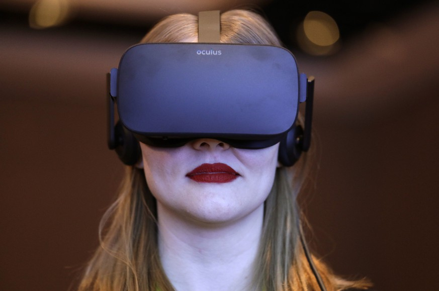FILE- In this Jan. 4, 2017, photo a woman participates in a virtual realty presentation during an Intel news conference before CES International in Las Vegas. The weeklong event is one of the world's largest trade shows and where many tech companies and startups go to show off their latest gadgets and more than 180,000 people are expected to attend CES this year. It is against this background that a growing number of people inside and out of the tech industry are urging organizers of events like CES to ensure that their roster of speakers features a broad array of people, diverse in gender, race as well as in their thinking.  (AP Photo/John Locher, File)
