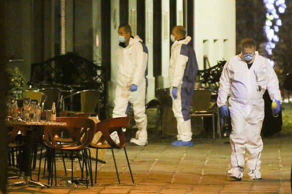 Three persons investigate at the scene following gunfire on people enjoying a last evening out before lockdown in the Austrian capital Vienna, early Tuesday, Nov. 3, 2020. Police in the Austrian capital said several shots were fired shortly after 8 p.m. local time on Monday, Nov. 2, in a lively street in the city center of Vienna. Austria's top security official said authorities believe there were several gunmen involved and that a police operation was still ongoing. (Photo/Ronald Zak)