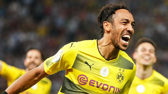 epa05994203 Dortmund's Pierre-Emerick Aubameyang celebrates after scoring the 2-1 lead from the penalty spot during the German DFB Cup final soccer match between Eintracht Frankfurt and Borussia Dortmund at the Olympic Stadium in Berlin, Germany, 27 May 2017.   (ATTENTION: The DFB prohibits the utilisation and publication of sequential pictures on the internet and other online media during the match (including half-time). ATTENTION: BLOCKING PERIOD! The DFB permits the further utilisation and publication of the pictures for mobile services (especially MMS) and for DVB-H and DMB only after the end of the match.)  EPA/FRIEDEMANN VOGEL