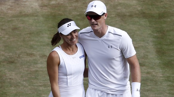 Martina Hingis of Switzerland and Jamie Murray of Great Britain after winning their mixed doubles match against Ken Skupski and Jocelyn Rae of Great Britain, during the Wimbledon Championships at the All England Lawn Tennis Club, in London, Britain, 13 July 2017. (KEYSTONE/Peter Klaunzer)