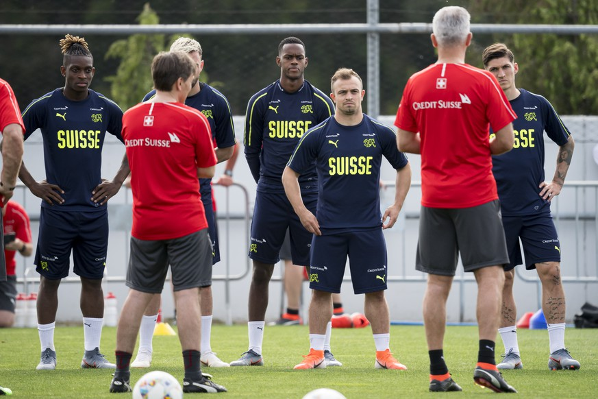 Switzerland's players Jacques Francois Moubandje, Edimilson Fernandes, Xherdan Shaqiri, and Steven Zuber from left to right react during a training session at the PortoGaia training center, in Crestuma near Porto, Portugal, Monday, June 3, 2019. Portugal will face Switzerland on June 5 in their UEFA Nations League soccer match in Porto. (KEYSTONE/Jean-Christophe Bott)