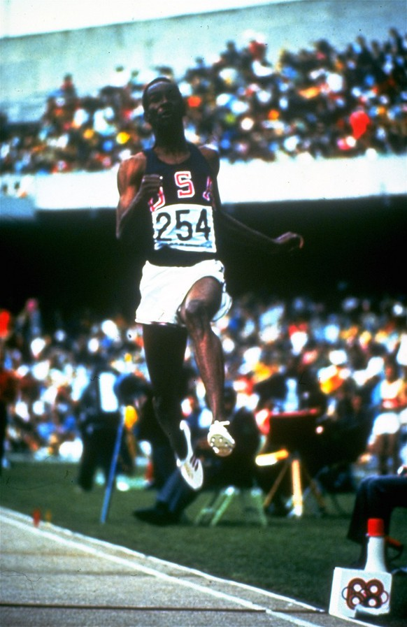 Bob Beamon is shown in his record-breaking long jump that won him a gold medal on October 18, 1968 during the 1968 Olympics in Mexico City.  (AP Photo)