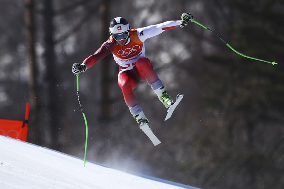 Switzerland's JustinMurisier skis during the downhill portion of the men's combined at the 2018 Winter Olympics in Jeongseon, South Korea, Tuesday, Feb. 13, 2018. (AP Photo/Alessandro Trovati)