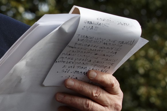 President Donald Trump holds handwritten notes as he speaks to the media about the House Intelligence Committee testimony of U.S. Ambassador to the European Union Gordon Sondland, Wednesday, Nov. 20, 2019, as Trump leaves the White House in Washington, en route to Texas. (AP Photo/Jacquelyn Martin) Donald Trump,Jared Kushner,Ivanka Trump
