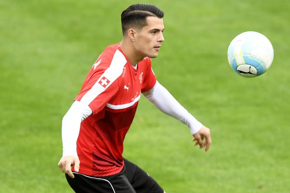 epa05571034 Swiss national soccer team player Granit Xhaka performs during his team's training session in Freienbach, Switzerland, 05 October 2016. Switzerland will face Hungary in the FIFA World Cup 2018 qualifying soccer match on 07 October 2016.  EPA/WALTER BIERI