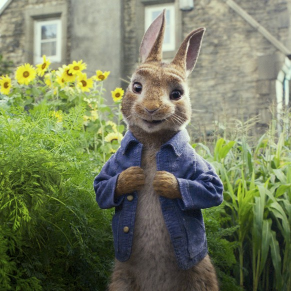 FILE - This image released by Columbia Pictures shows Peter Rabbit, voiced by James Corden and Cottontail in a scene from