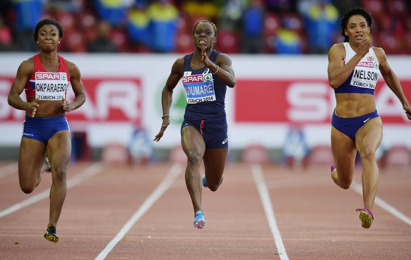France's Myriam Soumare (C) competes on her way to win ahead of Great Britain's Ashleigh Nelson (R) and Norway's Ezinne Okparaebo the Women's 100m semi-final during the European Athletics Championships at the Letzigrund stadium in Zurich on August 13, 2014.  AFP PHOTO / OLIVIER MORIN