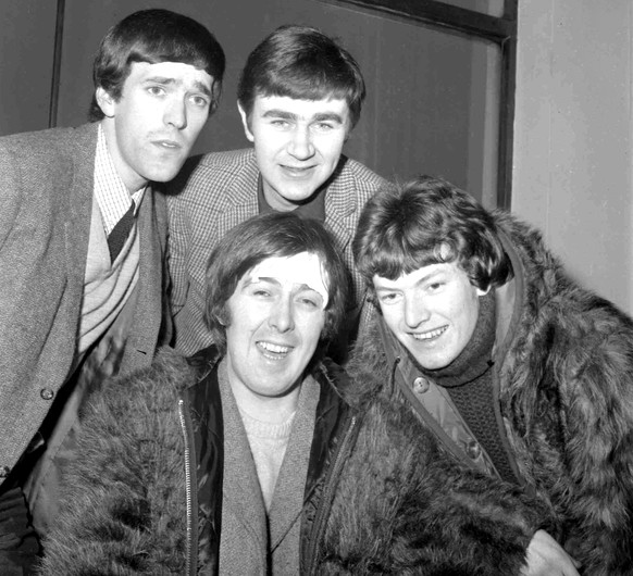 FILE  - In this Jan. 10, 1966 file photo, members of the band, the Spencer Davis Group, from top left: Muff Winwood, Pete York and Steve Winwood and Spencer Davis, foreground. British guitarist and bandleader Spencer Davis, whose eponymous rock group had 1960s hits including