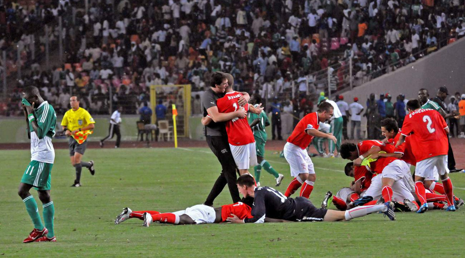 Switzerland  soccer players react after beating Nigeria during their U 17 World Cup soccer Final match in Abuja, Nigeria, Sunday, Nov. 15, 2009. (AP Photo/Sunday Alamba)