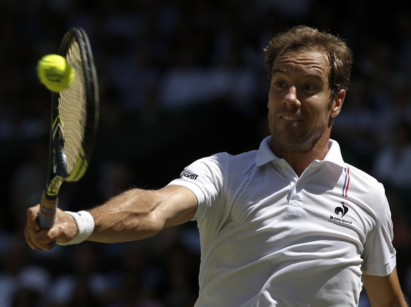 Richard Gasquet of France returns a shot to Novak Djokovic of Serbia during the men's singles semifinal match at the All England Lawn Tennis Championships in Wimbledon, London, Friday July 10, 2015. (Adrian Dennis, Pool Photo via AP)