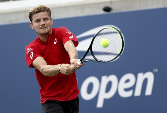 David Goffin, of Belgium, returns a shot to Pablo Carreno Busta, of Spain, during round three of the US Open tennis championships Friday, Aug. 30, 2019, in New York. (AP Photo/Kevin Hagen)