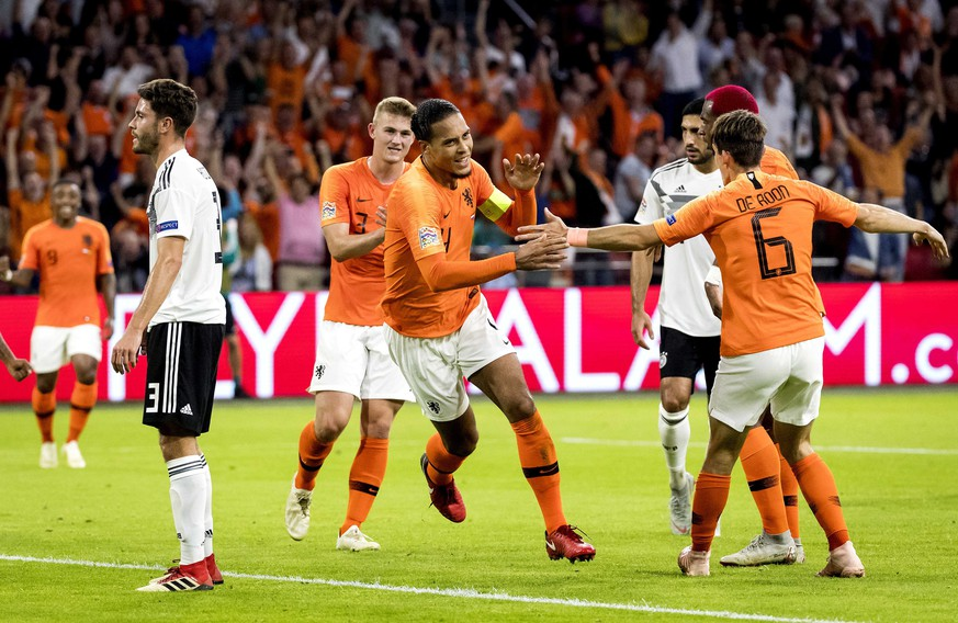 epa07091120 Virgil van Dijk (C) of the Dutch national team celebrates after he scored 1-0 during the UEFA Nations League, league A, group 1, soccer match between the Netherlands and Germany at Johan Cruijff ArenA in Amsterdam, Germany, 13 October 2018.  EPA/KOEN VAN WEEL DFB regulations prohibit any use of photographs as image sequences and/or quasi-video.