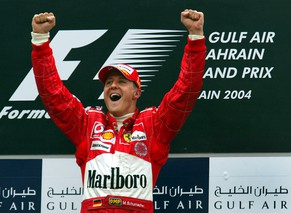 Germany's Michael Schumacher of Ferrari celebrates after winning the Bahrain Formula One Grand Prix, Sunday April 4, 2004. (AP Photo/John Moore)