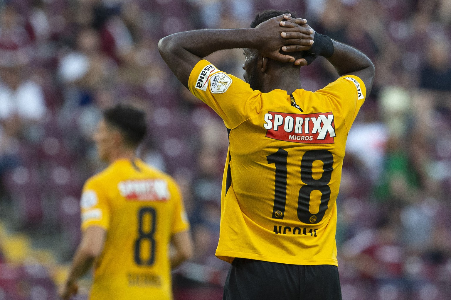 Young Boys' forward Jean-Pierre Nsame #18 reacts after missing a goal, during the Super League soccer match of Swiss Championship between Servette FC and BSC Young Boys, at the Stade de Geneve stadium, in Geneva, Switzerland, Tuesday, June 30, 2020. All Super League soccer matches of Swiss Championship are played to behind the semi closed doors (only 1000 persons can be present in the stadium) due to preventive measure against a second wave of the coronavirus COVID-19. (KEYSTONE/Salvatore Di Nolfi)