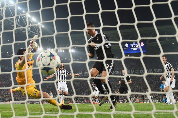 TURIN, ENGLAND - MAY 05:  Cristiano Ronaldo of Real Madrid CF heads the ball past goalkeeper Gianluigi Buffon of Juventus to score their first and equalising goal during the UEFA Champions League semi final first leg match between Juventus and Real Madrid CF at Juventus Arena on May 5, 2015 in Turin, Italy.  (Photo by Michael Regan/Getty Images)