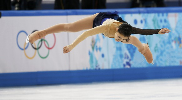 Japan's Kanako Murakami competes during the Figure Skating Women's free skating Program at the Sochi 2014 Winter Olympics, February 20, 2014.       REUTERS/Alexander Demianchuk (RUSSIA  - Tags: OLYMPICS SPORT FIGURE SKATING)
