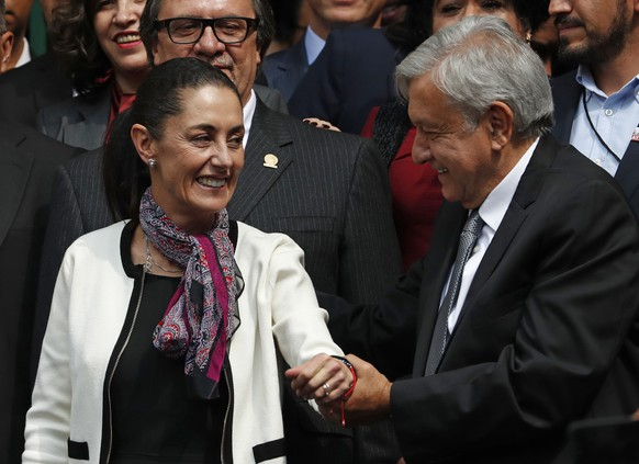 The first elected female mayor of Mexico City Claudia Sheinbaum, left, and President Andres Manuel Lopez Obrador, leave the Senate after she was sworn into office, in Mexico City, Wednesday, Dec. 5, 2018. (AP Photo/Moises Castillo)