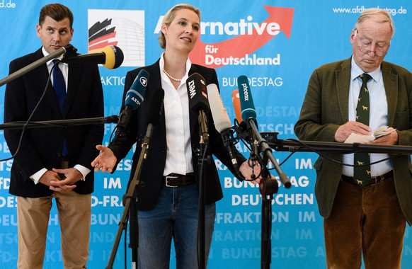 epa08384916 (FILE) - (L-R) Christian Lueth, spokesman of the German right-wing populist party Alternative for Germany (AfD), and the co-chairs of the parliamentary group Alice Weidel and Alexander Gauland during a media statement prior to an AfD parliamentary group meeting in Berlin, Germany, 12 June 2018 (re-issued on 26 April 2020). According to a 'Zeit Online' report on 26 April 2020, AfD spokesman Lueth was fired by faction co-chairman Gauland because Lueth described himself as a 'fascist' and being of 'arian' descent during an internal meeting.  EPA/CLEMENS BILAN