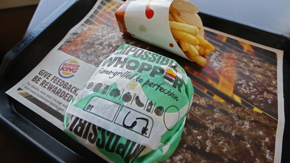 epa07803294 A posed photo shows an Impossible Whopper meal at a Burger King restaurant in Sulphur Springs, Texas, USA, 29 August 2019. Burger King has added a meatless burger called the Impossible Whopper to its menu.  EPA/LARRY W. SMITH