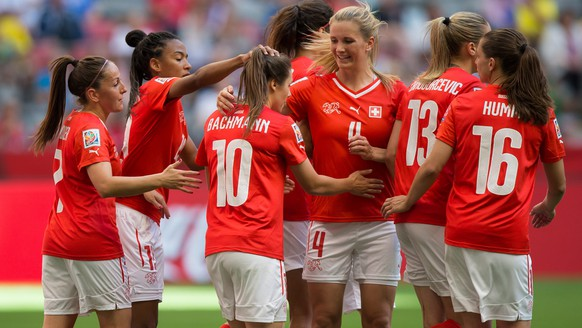 Switzerland's Ramona Bachmann (10) is congratulated by her teammates after scoring against Ecuador during the second half of a FIFA Women's World Cup soccer match Friday, June 12, 2015, in Vancouver, British Columbia, Canada. (Darryl Dyck/The Canadian Press via AP)