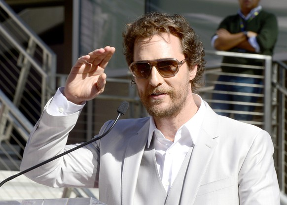 epa04493769 US Actor Matthew McConaughey salutes fans during a ceremony honoring him with a star on the Hollywood Walk of Fame in Hollywood, California, USA, 17 November 2014. McConaughey who stars in the newly released movie Interstellar received the 2,534th star in the motion picture category.  EPA/MICHAEL NELSON