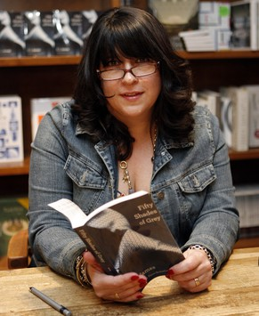 Author E L James holds a copy of her new erotic fiction book