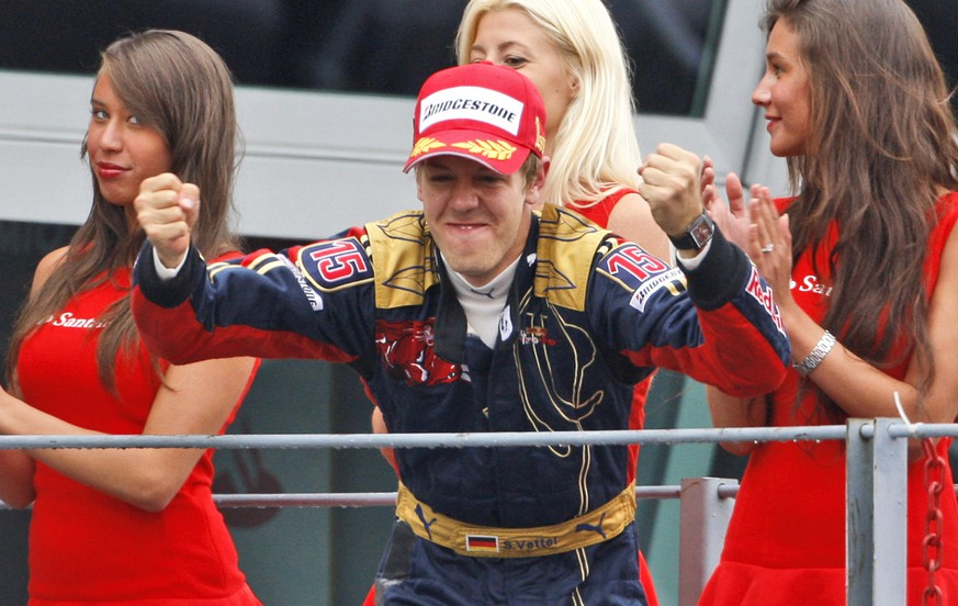Toro Rosso driver Sebastian Vettel, of Germany, celebrates on the podium after winning  the Formula One Grand Prix in Monza, Italy, Sunday, Sept.14, 2008. Sebastian Vettel has become the youngest driver to win a Formula One race after finishing first in a wet Italian Grand Prix from pole position. (AP Photo/Luca Bruno)
