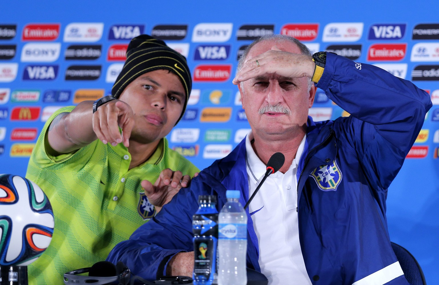 epa04311604 Brazil national soccer team head coach Luiz Felipe Scolari (R) and captain Thiago Silva (L) during a press conference at Estadio National in Brasilia, Brazil, 11 July 2014. Brazil will face The Netherlands on 12 July for the third place in the FIFA World Cup Brazil 2014 match at National Stadium in Brasilia.  EPA/ROBERT GHEMENT