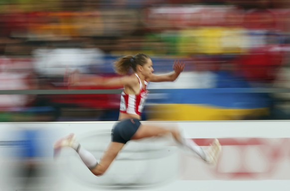 Natallia Viatkina of Belarus competes in the women's triple jump qualification during the European Athletics Championships at the Letzigrund Stadium in Zurich August 13, 2014.                                REUTERS/Phil Noble (SWITZERLAND  - Tags: SPORT ATHLETICS TPX IMAGES OF THE DAY)